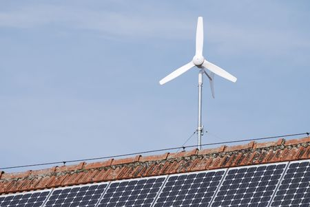 Alternative energy with solar panels and a wind engine Stock Photo - 6030064