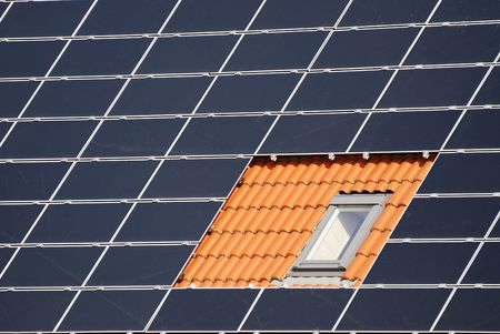 Roof with window between solar cells                       Stock Photo - 6030058