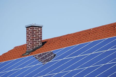 Tiled roof with photovoltaic cells. Stock Photo - 6606896