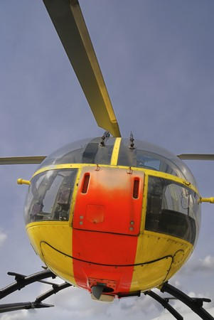 transportaion: Yellow rescue helicopter in the air.