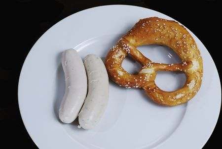 veal sausage: Traditional breakfast with bavarian veal sausage and pretzel.