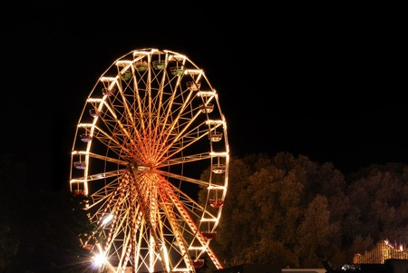 Ferris wheel at the fair ground at night. photo