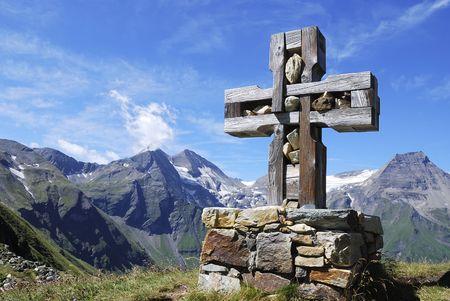 Cross at the Grossglockner Hochalpenstrasse (high alpine road) in Austria photo