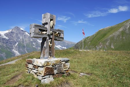 Cross at the Grossglockner Hochalpenstrasse (high alpine road) in Austria Stock Photo - 8030927