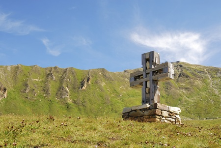 Cross at the Grossglockner Hochalpenstrasse (high alpine road) in Austria photo