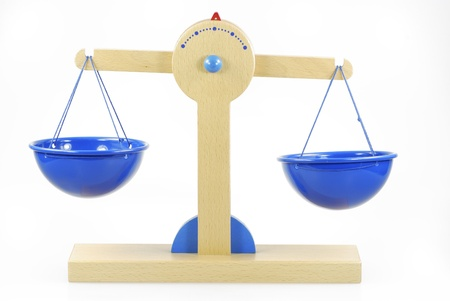 Wooden toy scales almost in balance Stock Photo - 8678398