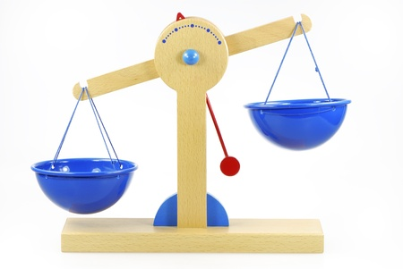 Wooden toy scales out of balance Stock Photo - 8746418