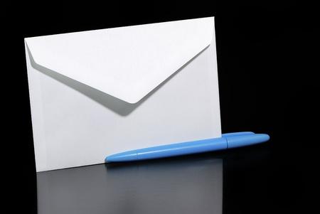 biro: White letter envelope and blue biro