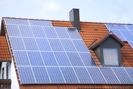 House roof with a photovoltaic system photo