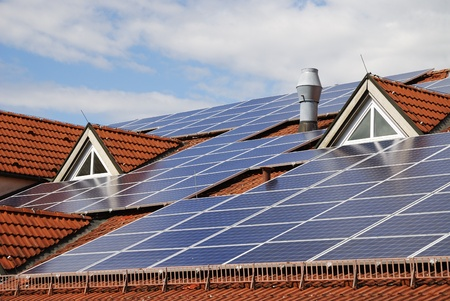 Photovoltaic system on the roof of a house photo