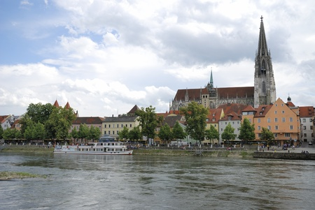 REGENSBURG, GERMANY - JUNE 21: Tourist boat in Regensburg on June 21, 2011. Since July 2006 Regensburg has been inscribed on the UNESCO List of World Heritage Sites. It has almost 3 million visitors a year.