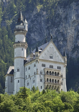 neuschwanstein: HOHENSCHWANGAU, GERMANY - JUNE 15: Neuschwanstein castle on June 15, 2011 in Hohenschwangau, Germany. The famous castle has over one million visitors a year. Editorial