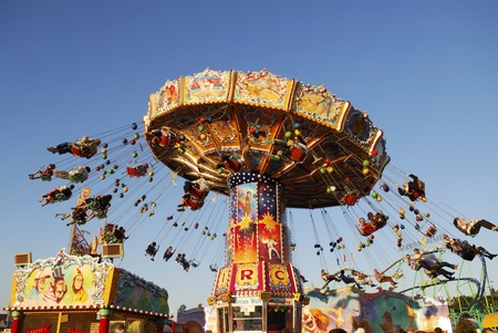 MUNICH, GERMANY - October 3: Chairoplane on the Oktoberfest in Munich, Germany on October 3, 2011. The Oktoberfest is the biggest beer festival of the world with over 6 million visitors each year.