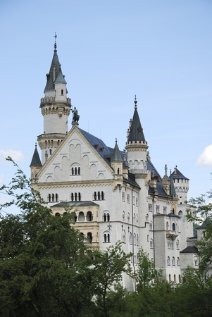 HOHENSCHWANGAU, GERMANY - JUNE 15: Neuschwanstein castle on June 15, 2011 in Hohenschwangau, Germany. The famous castle has over one million visitors a year.