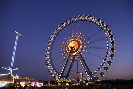 each year: MUNICH, GERMANY - October 3: Big wheel at the Oktoberfest in Munich, Germany on October 3, 2011. The Oktoberfest is the biggest beer festival of the world with over 6 million visitors each year.