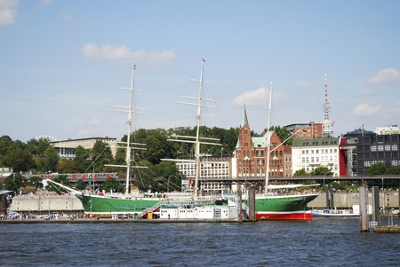 HAMBURG, GERMANY - AUGUST 20: Historic sailing ship Rickmer Rickmers in the port of Hamburg on August 20, 2011. The three masted bark from 1896 is permanently moored as a museum ship. Foto taken from a round trip boat.
