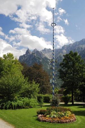 maypole: Traditional bavarian maypole in Mittenwald (Germany) Stock Photo