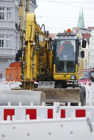 road works: Road works with a digger in the city