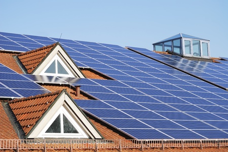 House roof with photovoltaics installation photo