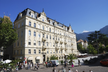 meran: MERAN, ITALY - SEPTEMBER 7: Tourists at the Passerpromenade in Meran, Italy on September 7, 2012. Meran is a famous italian spa town with a very mild climate. Foto taken on the Passerpromenade with view to the Hotel Esplanade. Editorial