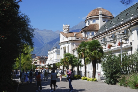 MERAN, ITALY - SEPTEMBER 7: Tourists at the Passerpromenade in Meran, Italy on September 7, 2012. Meran is a famous italian spa town with a very mild climate. Foto taken on the Passerpromenade with view to the Kurhaus. Stock Photo - 15850134