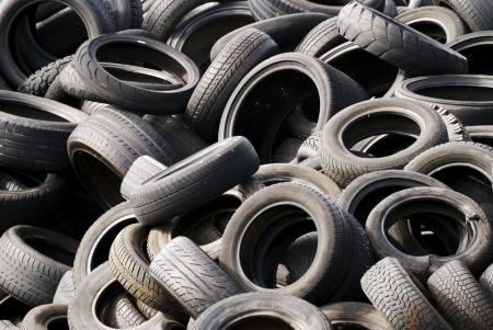 A waste heap of old tyres for rubber recycling photo