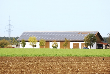 Solar panels on the roof of a farm house