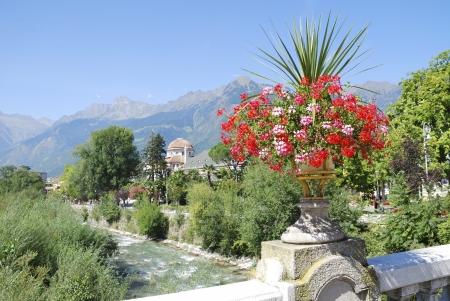 meran: Flowers in Meran on a bridge over the river Passer