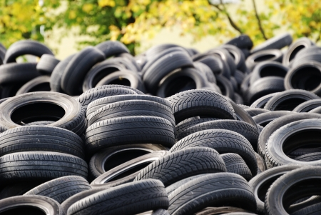 A waste heap of old tyres for rubber recycling Standard-Bild