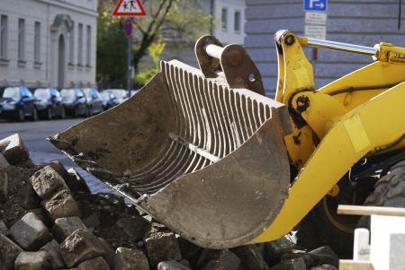 roadworks: Roadworks with a yellow excavator Stock Photo