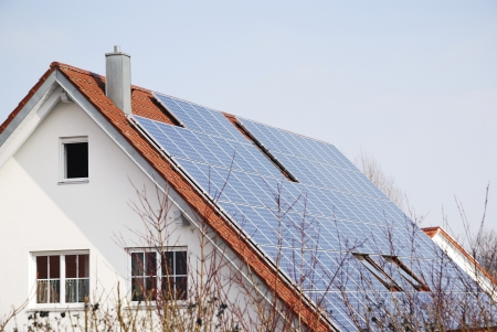 Alternative energy with photovoltaic panels on the roof photo