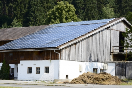 Alternative energy creation at a farm with solar panels on the roor photo