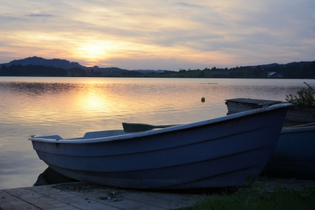 Boats at a lake in the alps of the Allgaeu (Bavaria, Germany) during sunset. photo