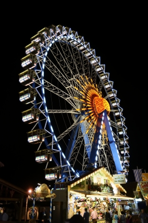 MUNICH, GERMANY - SEPTEMBER 25: Big wheel at the Oktoberfest in Munich, Germany on September 25, 2013. The Oktoberfest is the biggest beer festival of the world with over 6 million visitors each year.
