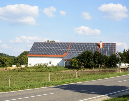 Barn of a farm with solar panels on the roof photo