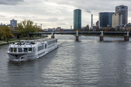 FRANKFURT, GERMANY - NOVEMBER 24: Tourists boat on the river Main in Frankfurt, Germany on November 24, 2013. Frankfurt is the largest financial centre in continental Europe. Foto taken from Eisener Steg bridge.