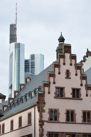roemerberg: The historic town hall of Frankfurt with a skyscraper in the background.