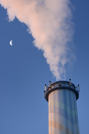 smolder: Smoke from a smokestack and the moon