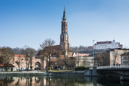 landshut: LANDSHUT, GERMANY - MARCH 8. Basilica St. Martin in Landshut, Germany on March 8, 2014. The basilica St. Martin on the right has the highest clinker tower of the world. Editorial