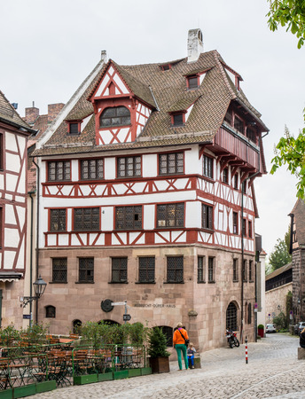 albrecht: NUERNBERG, GERMANY - APRIL 6: Tourist in front of the Albrecht Duerer House in Nuernberg, Germany on April 6, 2014. This was the home of the famous painter and mathematician Albrecht Duerer. Foto taken from Albrecht Duerer Street. Editorial