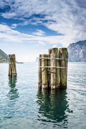 bollards: Wooden bollards in Lake Garda Stock Photo