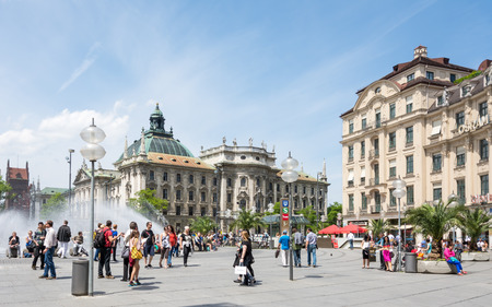 visitors area: MUNICH, GERMANY - JUNE 4: Tourists in the pedestrian area of Munich, Germany on June 4, 2014. Munich is the biggest city of Bavaria  with almost 100 million visitors a year. Foto taken from Karlsplatz with view to Justizpalast.