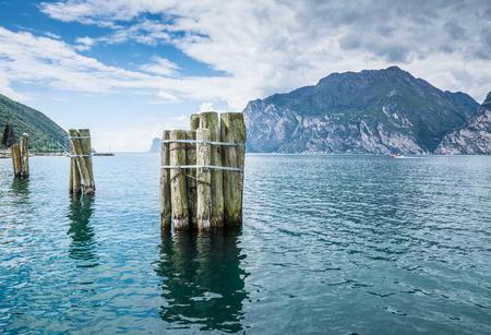 bollards: Wooden bollards in Lake Garda Stock Photo