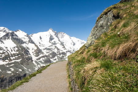 Alpine path at the Franz-Josef-Hoehe near the Grossglockner mountain in Austria photo