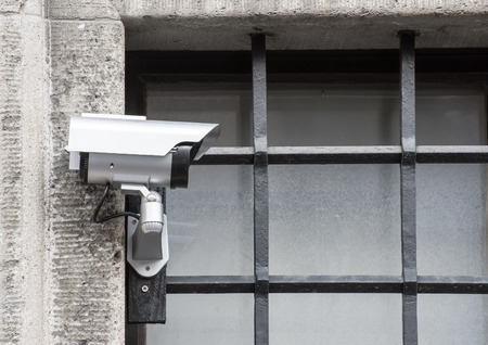 jailhouse: Security with a video surveillance camera at a jailhouse window Stock Photo