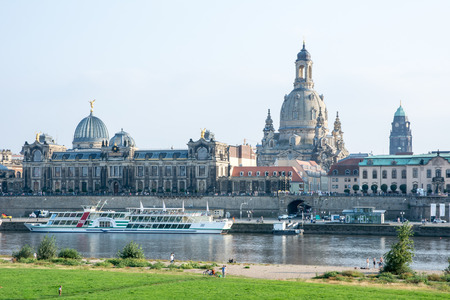 r fine: DRESDEN, GERMANY - SEPTEMBER 4: Tourists at the promenade of the river Elbe in Dresden, Germany on September 4, 2014. Dresden has almost 2 million visitors a year. Foto taken from Augustus bridge.