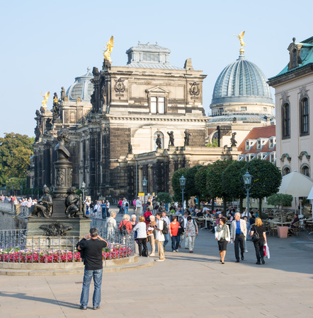 r fine: DRESDEN, GERMANY - SEPTEMBER 4: Tourists at the historic old town of Dresden, Germany on September 4, 2014. Dresden has almost 2 million visitors a year. Foto taken from Terassenufer.