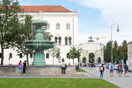 MUNICH, GERMANY - AUGUST 25: Tourists at the Ludwig Maximilian University of Munich, Germany on August 25, 2014. The university is among  the oldest universities of Germany. Foto taken from Geschwister Scholl Platz.
