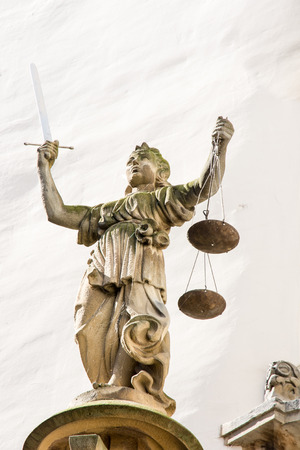 lady justice: Sculpture of Lady Justice (Justitia) from 1591 at the old town hall of Goerlitz Editorial
