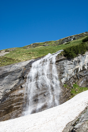 hochalpenstrasse: Waterfall and Snowmelt in the Hohe Tauern national park in Austria Stock Photo